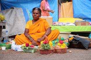 A simple women in the street of Mysore selling flowers.